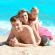 Family on the shore of the sea — Stock Photo #12167893