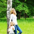 Stock Photo: Beautiful little girl with her mother on the nature