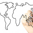 Hand draws a map of the world isolated on a white background - Stok fotoğraf
