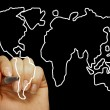 Hand draws a map of the world isolated on a black background - Stock Photo