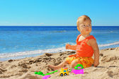 Child on the shore — Stock Photo