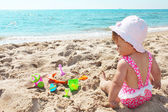 Baby on the shore of the sea — Stock Photo