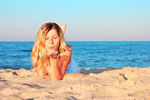 Young woman on the shore of the sea — Stock Photo