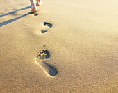 Footprints in the sand — Stockfoto