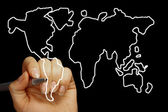 Hand draws a map of the world isolated on a black background — Stock Photo