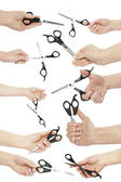 Scissors in hand — Stock Photo