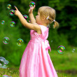 Little girl with bubbles - Stock Photo