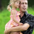A young father with his daughter on the nature — Stock Photo