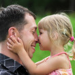 A young father with his daughter on the nature — Stock Photo #13268741