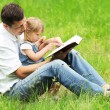 Dad and daughter reading the Bible — Stock Photo