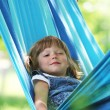 Little girl on a hammock - 图库照片
