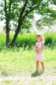 A beautiful little girl on the nature — Stock Photo