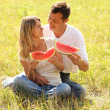 Couple in love eating watermelon outdoors — Stock Photo