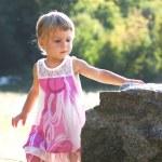 Beautiful little girl on nature — Stock Photo #13337112