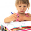 Beautiful little girl drawing with pencils — Stock Photo #13337150