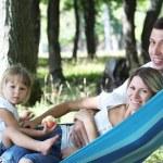 Family on a hammock — Stock Photo #13337162