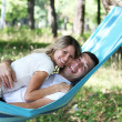 A young couple in love on a hammock - Stock Photo