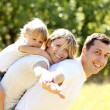 Young family in nature — Stock Photo #13411564