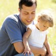 Beautiful little girl playing with her father in nature — Stock Photo #13411682