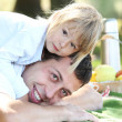 Beautiful little girl play with dad in nature — Stock Photo
