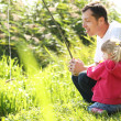 Stock Photo: Beautiful little girl with her father in nature on a lake