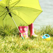 Rubber boots and umbrella - Stockfoto