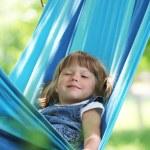 Little girl on a hammock — Stock Photo #13413265