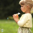 Little girl with soap bubbles — Stock Photo #13413443