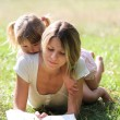 Stock Photo: Mother and daughter on the grass
