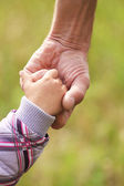 Father holding baby's hand — Stock Photo