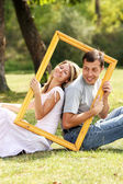 Couple in love in a frame on the nature — Stock Photo