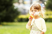 Little girl with soap bubbles — Stock fotografie