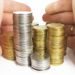 Hands and stacks of coins isolated — Stock Photo