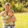 Little girl with her mother — Stock Photo