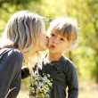 Beautiful little girl with her mother outdoors — Stock Photo #13831992