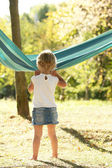 Beautiful young girl on nature with a hammock — Stock Photo