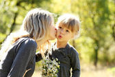 Beautiful little girl with her mother outdoors — Stock Photo
