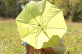 Beautiful little girl with umbrella outdoors — Stock Photo