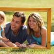 Family in a frame — Stock Photo #14248981