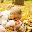 Young mother and her little daughter on the nature — Stock Photo #14248993