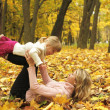 Stock Photo: Young mother and her little daughter on the nature