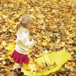 Beautiful little girl with umbrella outdoors — Stock Photo #14249191