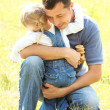 Beautiful little girl with father on nature — Stock Photo #14249257