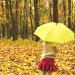 Beautiful little girl with umbrella outdoors — Stock Photo #14249265