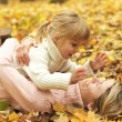 Young mother and her little daughter on the nature — Stock Photo #14249273