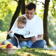 Dad and daughter reading the Bible — Stock Photo #14249293