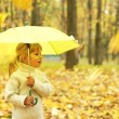 Beautiful little girl with umbrella outdoors — Stock Photo #14249339