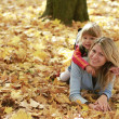 Young mother and her little daughter on the nature — Stock Photo #14249405