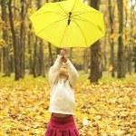 Beautiful little girl with umbrella outdoors — Stock Photo #14249435