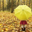Beautiful little girl with umbrella outdoors — Stock Photo #14249509